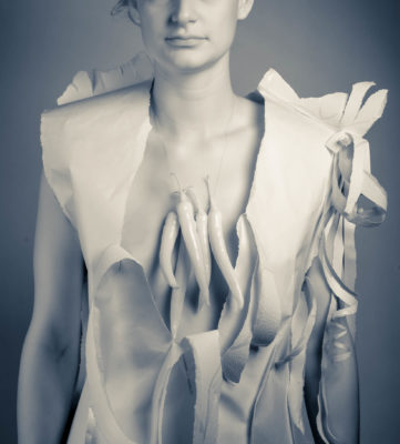Woman with paper dress and infrared peppers